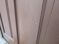 March 15, 2019 - Christchurch, New Zealand: Shotgun fraction stuck in the door of the hotel on Deans Avenue, at the crime scene. At least 49 have been killed, 48 wounded in shooting in two mosques in Christchurch, New Zealand. (Credit Image: © Alexander Romitsyn/Russian Look via ZUMA Wire)