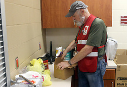 Red Cross Shelter Supervisor Scott Goldsmith opens a box with food and medical aid at the FEMA Dome after Hurricane Harvey displaced families, on Wednesday, August 30, 2017, at Tulsa-Midway High School in Corpus Christi, Texas, USA. Photo by Gabe Hernandez/Corpus Christi Caller-Times/TNS/ABACAPRESS.COM