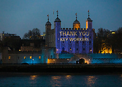© Licensed to London News Pictures. 09/04/2020. London, UK. Light projections onto the Tower of London this evening in recognition and appreciation of National Health Service (NHS) and key workers during the ongoing COVID-19 coronavirus epidemic. Photo credit: Vickie Flores/LNP