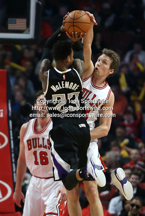 Feb. 10, 2015 - Chicago, IL, USA - Chicago Bulls forward Mike Dunleavy (34) goes up to block the shot of Sacramento Kings guard Ben McLemore (23) during the first half on Tuesday, Feb. 10, 2015, at the United Center in Chicago
