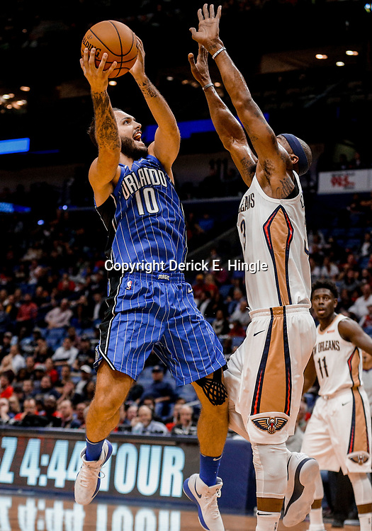 Oct 30, 2017; New Orleans, LA, USA; Orlando Magic guard Evan Fournier (10) shoots over New Orleans Pelicans forward Dante Cunningham (33) during the first quarter of a game at the Smoothie King Center. Mandatory Credit: Derick E. Hingle-USA TODAY Sports