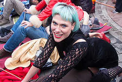 London, December 12th 2014. Porn and sex workers gather outside the Houses of Parliament for a mass sex simulation and face-sitting event in rotest against newly outlawed sex acts in the making of pornography in the UK. Under new Audiovisual Media Services Regulations 2014 rules, such acts as facesitting, spanking and female ejaculation are, among others, now banned from being shown  porn watched online. PICTURED: A face-sitter smiles for the camera