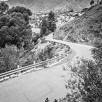 Catalina Island winding mountain road black and white picture. Santa Catalina Island is off the coast of Southern California and is a popular travel and vacation destination.