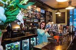 Assistant Manager Timi Moldovan plus a pint at The Carpenters Arms Cheshire Street in East London's Bethnal Green, which was once the scene of frivolous parties hosted by Reggie and Ronnie Kray, who dominated the capital's criminal underworld in the 50s and 60s. In 1967 they bought the pub for their mother, two years before they were given life sentences for their crimes. LONDON, January 10 2019.