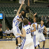 Guard Travon Williams (10) lays up for 2 in a crowd of Blue Jay defenders including center Jared Walde (54) and guard Jordan Stapp  (22).