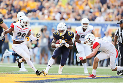 Sep 16, 2017; Morgantown, WV, USA; West Virginia Mountaineers running back Justin Crawford (25) runs the ball during the first quarter against the Delaware State Hornets at Milan Puskar Stadium. Mandatory Credit: Ben Queen-USA TODAY Sports