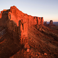 USA, Arizona, Monument Valley Navajo Tribal Park, Aerial view of towering sandstone mesa known as Brigham's Tomb at sunset