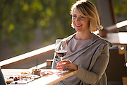 Woman enjoying food & wine tasting at Adelaida, Lifestyle wine tasting, Paso Robles, California enjoying food & wine tasting at Adelaida, Lifestyle wine tasting, Paso Robles, California