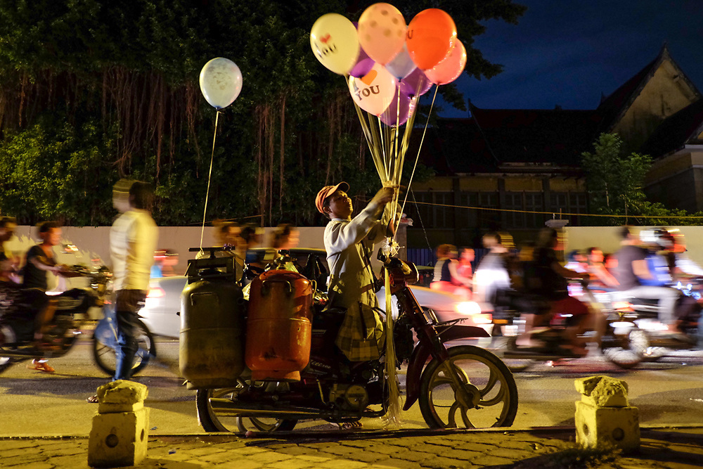 Balloon seller in a street of Phnom Penh, Cambodia. Photo by Lorenz Berna
