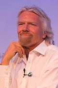 Sir Richard Branson speaks to audience during Virgin Galactic space tourism presentation at Farnborough Air Show.