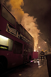 © Licensed to London News Pictures. 22/01/2012. London, U.K. A London bus on Archway road catches fire. The bus was on it's way to the bus depot and no passengers were on the bus at the time. Traffic was affected in the area. Photo credit : Rich Bowen/LNP