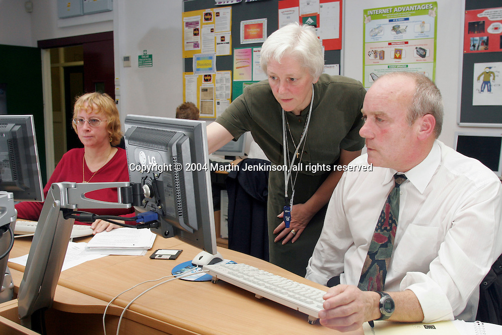 Terry Phillips, Tibshelf Community School, and tutor Judi Machin in background Jane Fearnley, Brampton Primary. NUT ICT course at Chesterfield College...© Martin Jenkinson, tel 0114 258 6808 mobile 07831 189363 email martin@pressphotos.co.uk. Copyright Designs & Patents Act 1988, moral rights asserted credit required. No part of this photo to be stored, reproduced, manipulated or transmitted to third parties by any means without prior written permission