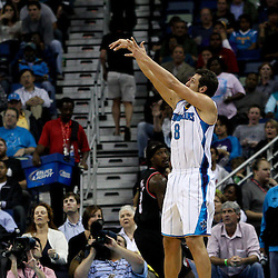 March 30, 2011; New Orleans, LA, USA; New Orleans Hornets shooting guard Marco Belinelli (8) shoots against the Portland Trail Blazers during the third quarter at the New Orleans Arena. The Hornets defeated the Trail Blazers 95-91.   Mandatory Credit: Derick E. Hingle
