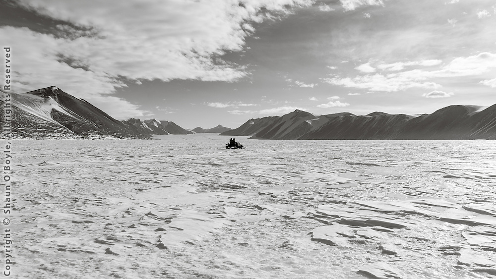 Snow mobiling across New Harbor at the Ferrar Glacier