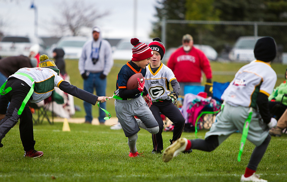 Players from Cross Plains and Cottage Grove compete in the 4th Grade Flag Football Championships at Hometown USA Community Park in Verona, Wisconsin, Saturday, October 28, 2017.