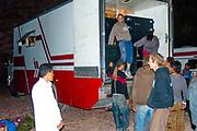 Ravers unloading a lorry at Middle East Tek, Wadi Rum, Jordan, 2008