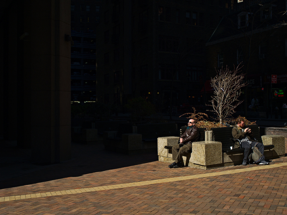 Two men on benches, New York, NY, US