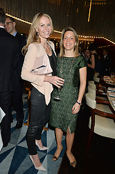 Left to right, CARO GREENWOOD and HETTY PYE at a dinner hosted by AA Gill & Nicola Formby in support of the Borne charity held at Rivea at the Bulgari Hotel, Knightsbridge, London on 3rd February 2015.