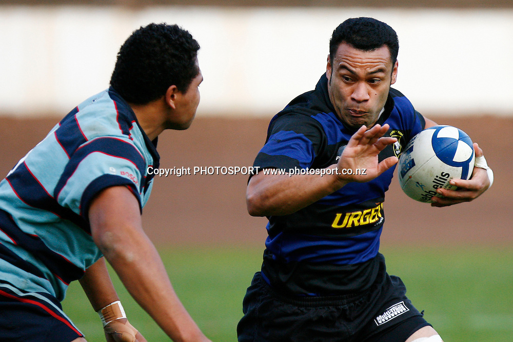 Ponsonby Roger Tuamoheloa looks to fend off Marist Peter Sailli during the Waka Nathan Challenge Cup Final, Auckland Premier Club Rugby match, Ponsonby v Marist at Western Springs Stadium, Auckland, New Zealand. Saturday 6 June 2009. Photo: Anthony Au-Yeung/PHOTOSPORT