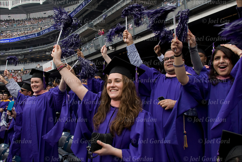 Crowd of females and one male at NYU college graduation in caps and gowns.<br /> <br /> Women out number males, more women are graduating college today. This is one of life's major events.