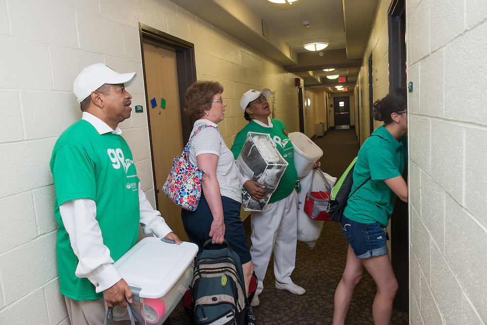 Ohio University President Roderick McDavis (Left) and First Lady Deborah McDavis (Center Right) assist Harriet Neldon (Center Left) and first year student Alice Neldon move into Lincoln Hall. Photo by Ben Siegel
