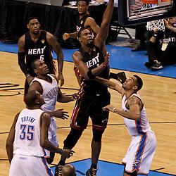 Jun 14, 2012; Oklahoma City, OK, USA;  Miami Heat power forward Chris Bosh (1) shoots over Oklahoma City Thunder power forward Serge Ibaka (9), small forward Kevin Durant (35) and shooting guard Thabo Sefolosha (2)during the second quarter of game two in the 2012 NBA Finals at Chesapeake Energy Arena. Mandatory Credit: Derick E. Hingle-US PRESSWIRE
