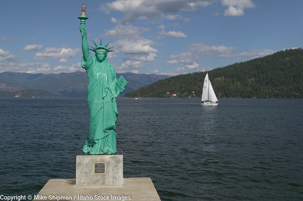 Idaho, Bonner County, Sandpoint, Lake Pend Oreille, City Beach, Statue of Liberty and sailboat