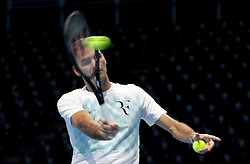 Roger Federer warms up on court ahead of the Andy Murray Live Event at the SSE Hydro, Glasgow.