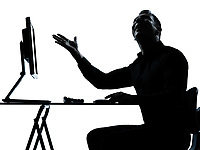 one caucasian business man computer computing happy silhouette in studio isolated on white background