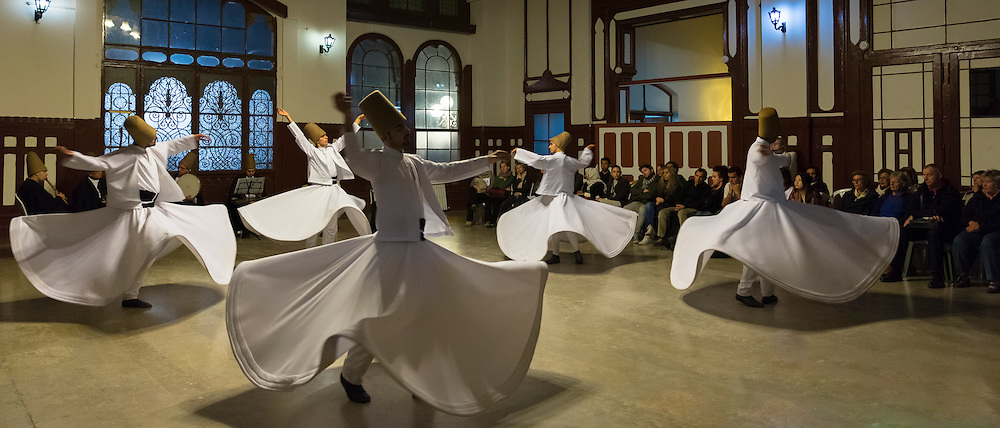 Tourists at Whirling Dervish ayin music performance - Mevlevi Sema - ceremony (whirling dervishes), Istanbul, Republic of Turkey