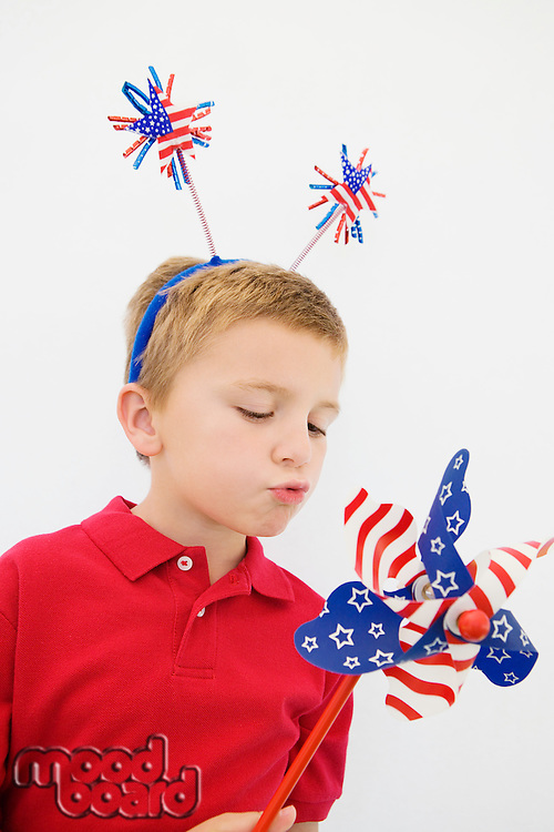 Boy Playing with Stars and Stripes Pinwheel