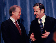 President Carter with  President Hafiz al-Asad, Syria on March 9, 1977<br /> President Carter's remarks:<br /> PRESIDENT CARTER. It's with a great deal of pleasure and hope that I come to Geneva to meet with the great President of Syria, President Asad. As a leader .of one of the great countries in the Middle East, I look to him for guidance and advice and for support as all of us search for progress in achieving peace in that important and troubled part of the world.<br /> Photo by Dennis Brack