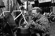 Guy helping himself to a beverage inside the beer barrel, 12v Teknival, Bristol, UK, November 2011