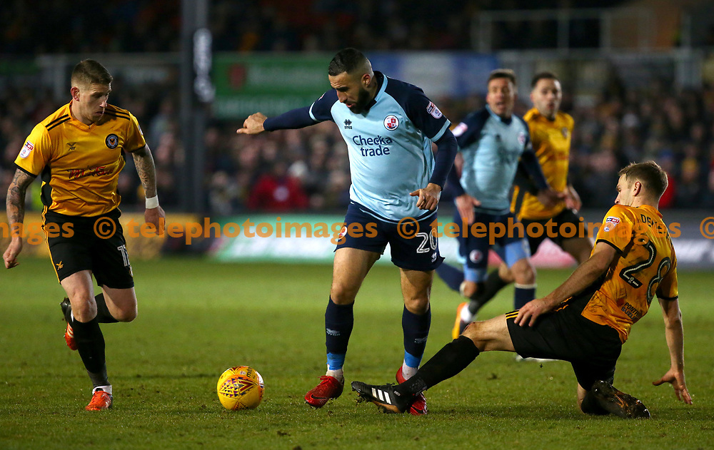 Mickey Demetriou of Newport tackles Crawley's Aryan Tajbakhsh during the Sky Bet League 2 match between Newport County and Crawley Town at Rodney Parade in Newport. January 19th, 2017.<br /> James Boardman / Telephoto Images<br /> +44 7967 642437