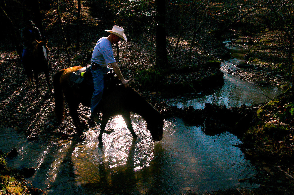 Jeff Smith crosses a stream on horseback during a saddleback Bible study trail ride in Morrow Mountain. The ride lasts generally four hours with a break to read and discuss passages out of the Bible.