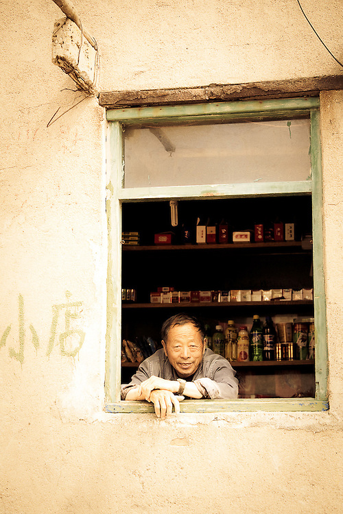 chinese man shop keeper