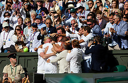 LONDON, ENGLAND - Sunday, July 6, 2014: Novak Djokovic (SRB) celebrates with his coaching team after winning the Gentlemen's Singles Final match 6-7 (7), 6-4, 7-6 (4), 5-7 (4), 6-4 on day thirteen of the Wimbledon Lawn Tennis Championships at the All England Lawn Tennis and Croquet Club. (Pic by David Rawcliffe/Propaganda)