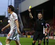 Dean Whitehead yellow card during the Sky Bet Championship first leg play off match between Brentford and Middlesbrough at Griffin Park, London, England on 8 May 2015. Photo by Matthew Redman.