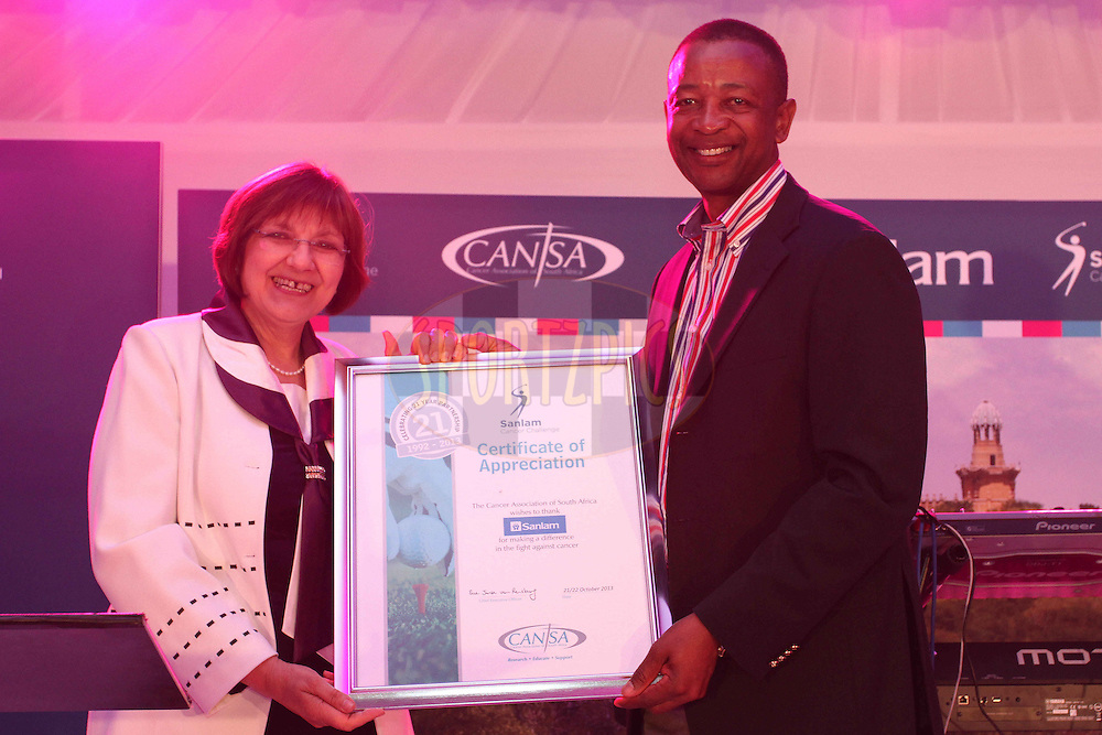 Sue Janse van Rensburg (Cansa) presents Temba Mvusi Chief Executive Market Development Sanlam a certificate of Appreciation during the Prize Giving Dinner  of the Sanlam Cancer Challenge Finals held at the Gary Player Country Club in Sun City near Johannesburg on the 22nd October 2013<br /> <br /> Photo by Shaun Roy - SPORTZPICS