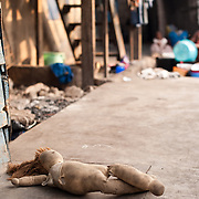 A child's doll lies beside an alleyway in Agbogbloshie, a slum in Ghana's capital, Accra.