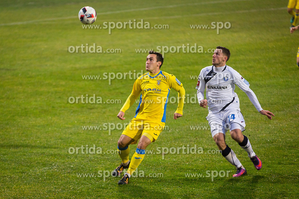 Luka Volaric of NK Domzale and Matej Podlogar of NK Celje during football match between NK Domzale and NK Celje in Round #18 of Prva liga Telekom Slovenije 2016/17, on November 26, 2016 in Sports park Domzale, Slovenia. Photo by Ziga Zupan / Sportida