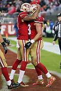 San Francisco 49ers tight end Vance McDonald (89) celebrates with San Francisco 49ers quarterback Colin Kaepernick (7) after McDonald catches an 18 yard touchdown pass that cuts the New England Patriots second quarter lead to 13-10 during the 2016 NFL week 11 regular season football game against the New England Patriots on Sunday, Nov. 20, 2016 in Santa Clara, Calif. The Patriots won the game 30-17. (©Paul Anthony Spinelli)