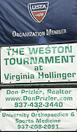 The USTA banner along with sponsor signs hang on the fence during the 41st Weston Memorial Tennis Tournament at the Virginia Hollinger Memorial Tennis Club, Monday, May 26, 2008.