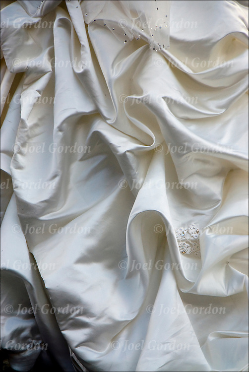 Close up of white fabric of bridal wedding gown
