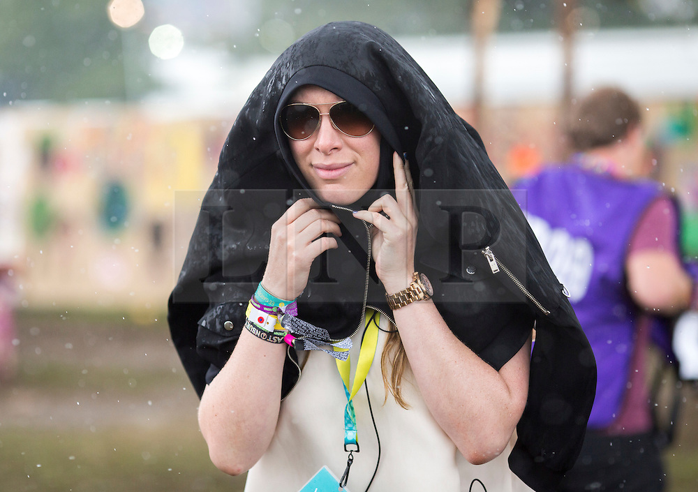 © Licensed to London News Pictures. 24/06/16. Revellers enjoy the wet weather today at the Glastonbury Festival in Pilton, Somerset. Photo credit should read Brad Wakefield/LNP