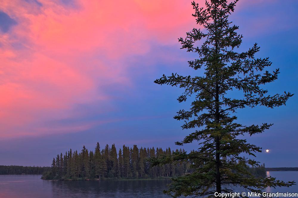 Lake Athapapuskow at dusk with moon<br />Near Bakers Narrows<br />Manitoba<br />Canada