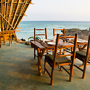 Dining at sunset on the patio of the main lodge. Chumbe Island Coral Park, Zanzibar, Tanzania is an internationally-awarded eco-resort and the first private, not-for-profit marine preserve in the world.
