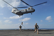 Marines assigned to the 11th Marine Expeditionary Unit (11th MEU) fast rope from a CH-46E Sea Knight helicopter onto the flight deck of the amphibious assault ship USS Makin Island (LHD 8). Makin Island is on its first operational deployment conducting operations in the U.S. 5th Fleet area of responsibility in support of the Navy's Maritime Strategy. Makin Island is the Navy's newest amphibious assault ship and the only U.S. Navy ship with a hybrid electric propulsion system. (U.S. Navy photo by Chief Mass Communication Specialist John Lill/Released)