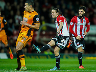 Jake Livermore of Hull City and Lasse Vibe of Brentford during the Sky Bet Championship match between Brentford and Hull City at Griffin Park, London<br /> Picture by Mark D Fuller/Focus Images Ltd +44 7774 216216<br /> 03/11/2015