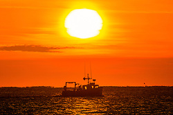 © Licensed to London News Pictures. 29/09/2018. Scarborough UK. A fishing boat leaves Scarborough harbour at sunrise this morning in Yorkshire. Photo credit: Andrew McCaren/LNP